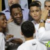 Photo - Soccer great, Pele pose for a photo next to young players of the Santos soccer team during the inauguration of the Pele Museum in Santos, Brazil, Sunday, June 15, 2014. The Pele Museum exhibits his personal collection, pictures, films, trophies and printed material about his history as a soccer player and personality. (AP Photo/Nelson Antoine)