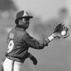 Photo - FILE - In this March 6, 1985 file photo, San Diego Padres' Tony Gwynn does a twist to make a back hand catch at the teams' spring training camp in Yuma, Ariz. Gwynn, the Hall of Famer with a sweet left-handed swing who spent his entire 20-year career with the Padres and was one of San Diego's most beloved athletes, died of cancer Monday, June 16, 2014. He was 54. (AP Photo/Lenny Ignelzi, File)