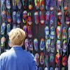 An art enthusiast looks at brightly painted shoes at an art booth at the Festival of the Arts in downtown Oklahoma City, OK, Thursday, April 25, 2013, By Paul Hellstern, The Oklahoman