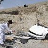 Afghans look at the wreckage of a vehicle after the roadside explosion on the outskirts of Laghman province east of Kabul, Afghanistan, Sunday, Aug. 12, 2012. A provincial spokesman says a roadside bomb has killed a district chief in eastern Afghanistan and three of his bodyguards. (AP Photo/Rahmat Gul)