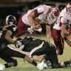 Wynnewood\'s Trey Knowles (32) leaps over defensive linemen as the Wayne Bulldogs play the Wynnewood Savages in district 5 class A high school football on Friday, Oct. 28, 2011, in Wayne, Okla. Photo by Steve Sisney, The Oklahoman ORG XMIT: KOD
