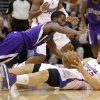 Sacramento Kings\' Aaron Brooks, top, and Los Angeles Clippers\' Blake Griffin dive for a loose ball during the first half of an NBA basketball game in Los Angeles, Friday, Dec. 21, 2012. (AP Photo/Chris Carlson)