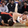 Photo - New York Knicks' Beno Udrih (18), of Slovenia, dives past Toronto Raptors' DeMar DeRozan during the first half of an NBA basketball game Friday, Dec. 27, 2013, in New York. (AP Photo/Frank Franklin II)