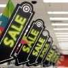 Sale signs are displayed at a Target store in Colma, Calif. Big retailers, from Best Buy to Target to Toys R Us, are engaging in a price war this holiday season, and shoppers can score some good deals if they know how to navigate them. But what\'s different this holiday season is that Best Buy and Target are matching online retailers such as Amazon.com for the first time. That\'s a big deal, since online prices tend to be lower than those in the store. AP Photo Jeff Chiu