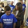 U.S. Rep. Michele Bachmann signs supporter\'s T-shirts during a visit to her St. Cloud, Minn., campaign headquarters Saturday, Nov. 3, 2012. (AP Photos/The St. Cloud Times, Dave Schwarz) NO SALES