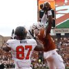 UT\'s Adrian Phillips (17) attempts to pick of a pass as Oklahoma State\'s Tracy Moore (87) prepares to make a touchdown pass during a college football game between the Oklahoma State University Cowboys (OSU) and the University of Texas Longhorns (UT) at Darrell K Royal - Texas Memorial Stadium in Austin, Texas, Saturday, Nov. 16, 2013. Photo by Sarah Phipps The Oklahoman