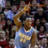 Photo -   Denver Nuggets forward Kenneth Faried celebrates after dunking the ball during the first half of an NBA basketball game against the Miami Heat, Saturday, Nov. 3, 2012 in Miami. (AP Photo/Wilfredo Lee)
