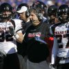Texas Tech University coach Mike Leach, center, watches his team during the first half of an NCAA college football game against Kansas in Lawrence, Kan., Saturday, Oct. 25, 2008. (AP Photo/Orlin Wagner) ORG XMIT: KSOW104