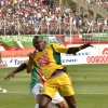 Photo - In this photo dated May 2, 2014, JS Kabylie striker Albert Ebosse of Cameroon tries to control the ball during the final of the Algerian soccer Cup in Blida near the Algerian capital, Algiers. Ebosse died after being hit in the head by an object thrown from the crowd at a top-flight league game in Algeria last August 23, 2014. Angry fans in Algeria pelted their own soccer team with rocks after they lost a game, killing the star player in the latest incident of fan violence in this North African country. Like much of the rest of the continent, Algeria's restless youth are passionate about soccer but with little other outlet for their daily frustration, violence haunts the games. (AP Photo)