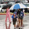 Parents dropping off students as a thunderstorm moves through on the first day of school at Rose Union Elementary School in the Deer Creek School District in Oklahoma City Thursday, Aug. 11, 2011. Photo by Paul B. Southerland, The Oklahoman