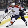Photo - Florida Panthers' Brad Boyes, left, and Columbus Blue Jackets' Fedor Tyutin, of Russia, chase a loose puck during the first period of an NHL hockey game Son aturday, Feb. 1, 2014, in Columbus, Ohio. (AP Photo/Jay LaPrete)