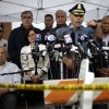 State Police Col. Timothy Alben, at podium, accompanied by Massachusetts Governor Deval Patrick, second right, and Boston Mayor Thomas Menino, lower left, gestures during a news conference regarding manhunt for Boston Marathon bombings suspect Dzhokar Tsarnaev, Friday, April 19, 2013, in Watertown, Mass. Alben said that he believed the19-year-old college student Tsarnaev was still in Massachusetts because of his ties to the area. But authorities lifted the stay-indoors warning for people in the Boston area, and the transit system started running again by evening. (AP Photo/Matt Rourke) ORG XMIT: MAMR140