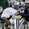 Edmond Santa Fe\'s Brandon Reece is brought down by Edmond North\'s Jarech Page, left, Nick Washburn, and Nic Imel during a high school football game at Wantland Stadium in Edmond, Okla., Friday, Oct. 29, 2010. Photo by Bryan Terry, The Oklahoman