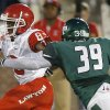 Lawton\'s Mykhail Shaw fights off Edmond Santa Fe\'s Carlos Washington during their high school football game at Wantland Stadium in Edmond, Okla., Thursday, October 11, 2012. Photo by Bryan Terry, The Oklahoman
