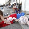 People wait outside the Department of Motor Vehicles in Edmond, OK, at 6:45 AM, Friday, July 20, 2012. Some arrived at 4 a.m. to begin the wait. By Paul Hellstern, The Oklahoman
