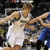 Photo -   Orlando Magic's Nikola Vucevic, right, of Montenegro, tries to slow down Minnesota Timberwolves' Andrei Kirilenko, of Russia, during the first half of an NBA basketball game Wednesday, Nov. 7, 2012, in Minneapolis. (AP Photo/Jim Mone)