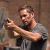 "Photo - This image released by Relativity Media shows Paul Walker in a scene from ""Brick Mansions."" (AP Photo/Relativity Media, Philippe Bosse)"