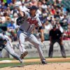 Photo - Atlanta Braves starting pitcher Mike Minor pitches to the Chicago White Sox in the first inning in a baseball game in Chicago, Sunday, July 21, 2013. (AP Photo/Charles Cherney)