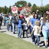 Photo - Hundreds of walkers set off for the annual three-mile CROP Walk to Stop Hunger in Norman. PHOTO BY LYNETTE LOBBAN, FOR THE OKLAHOMAN