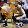 Utah Jazz\'s Mo Williams, right, grabs a loose ball as Phoenix Suns\' Diante Garrett (10) watches in the second quarter during an NBA basketball game, Wednesday, March 27, 2013, in Salt Lake City. (AP Photo/Rick Bowmer)