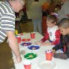 Charlie Stowe helps Che Wylie and Mikayla Johnston do handprint pictures at the Arts and Crafts booth at the Family Fall Festival and Trunk or Treat event at First Christian Church in Guthrie on Sunday, Oct. 28. Community Photo By: Karen Allen Submitted By: Karen,