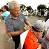 Colin Montgomerie gives an autograph to Keagan Knight, 12, before the first round of the U.S. Senior Open Championship golf tournament at Oak Tree National in Edmond, Okla. on Thursday, July 10, 2014. Photo by Steve Sisney, The Oklahoman