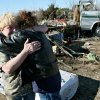 Margie Hughes (left) gets a hug from her sister Neda Wilson as they look at Margie\'s destroyed home following deadly storms around Lone Grove, Okla., Feb. 11, 2009. By John Clanton, The Oklahoman