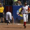 Alabama\'s Cassie Reilly-Boccia (18) celebrates after tagging California\'s Danielle Henderson (8) during a Women\'s College World Series game between Alabama and California at ASA Hall of Fame Stadium in Oklahoma City, Sunday, June 3, 2012. Photo by Garett Fisbeck, The Oklahoman