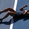 Photo - Dominika Cibulkova of Slovakia celebrates after defeating  Agnieszka Radwanska of Poland during their semifinal at the Australian Open tennis championship in Melbourne, Australia, Thursday, Jan. 23, 2014.(AP Photo/Eugene Hoshiko)