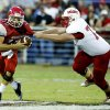 Washington quarterback Brock Harmon tries to slip the tackle by Purcell\'s Colby Lindsey in high school football on Friday, Sept. 13, 2013 in Washington, Okla. Photo by Steve Sisney, The Oklahoman