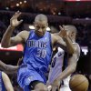 Dallas Mavericks\' Dahntay Jones (30) goes after a loose ball as he collides with Memphis Grizzlies\' Darrell Arthur, right, during the first half of an NBA basketball game in Memphis, Tenn., Friday, Dec. 21, 2012. (AP Photo/Danny Johnston)