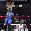 Oklahoma City\'s Kevin Durant (35) dunks beside Memphis\' Beno Udrih (19) and James Johnson (3) during Game 6 in the first round of the NBA playoffs between the Oklahoma City Thunder and the Memphis Grizzlies at FedExForum in Memphis, Tenn., Thursday, May 1, 2014. Oklahoma City won 104-84. Photo by Bryan Terry, The Oklahoman