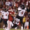 Texas Tech\'s Tre\' Porter (5) intercepts a pass beside Oklahoma\'s Kenny Stills (4) during the college football game between the University of Oklahoma Sooners (OU) and the Texas Tech University Red Raiders (TTU) at Gaylord Family-Oklahoma Memorial Stadium in Norman, Okla., Saturday, Oct. 22, 2011. Photo by Bryan Terry, The Oklahoman