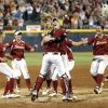 Oklahoma celebrates their championship win following the Women\'s College World Series softball game between Oklahoma and Tennessee at ASA Hall of Fame Stadium in Oklahoma City,Tuesday, June, 4, 2013. Photo by Sarah Phipps, The Oklahoman