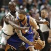 New York Knicks center Tyson Chandler looks for an opening around Boston Celtics\' Kevin Garnett during the first quarter of Game 3 of a first round NBA basketball playoff series in Boston Friday, April 26, 2013. (AP Photo/Winslow Townson)
