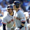 Photo - San Francisco Giants' Michael Morse, left, congratulates teammate Buster Posey for hitting a solo home run against the Los Angeles Dodgers in the fifth inning of a baseball game on Saturday, April 5, 2014, in Los Angeles. (AP Photo/Alex Gallardo)