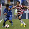 United States\' Jose Torres, right, nudges El Salvador\'s Andres Flores Mejia out of the way while trying to steal the ball during the second half in the quarterfinals of the CONCACAF Gold Cup soccer tournament on Sunday, July 21, 2013, in Baltimore. The United States won 5-1. (AP Photo/Patrick Semansky)