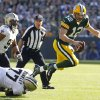 Green Bay Packers quarterback Aaron Rodgers gets tripped up by New Orleans Saints defensive tackle Brodrick Bunkley as defensive end Will Smith watches during the first half of an NFL football game Sunday, Sept. 30, 2012, in Green Bay, Wis. (AP Photo/Mike Roemer)