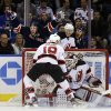 Photo - New York Rangers' Ryan Callahan, rear left, celebrates after scoring a goal on New Jersey Devils goalie Martin Brodeur, bottom, during the first period of an NHL hockey game, Sunday, April 21, 2013, in New York. (AP Photo/Seth Wenig)