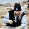FILE - In this Jan. 20, 2012 file photo Sarah Riner, from Dalton, Ga., preserves bricks from the Volunteer House in Joplin, Mo. Since the May 22 tornado, thousands of volunteers have come to Joplin to help, including many Joplin natives that have given up careers elsewhere to come home to help with the town\'s long recovery. (AP Photo/The Joplin Globe, T. Rob Brown, File) ORG XMIT: MOJOP501