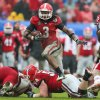 Photo - Georgia's Todd Gurley carries against Nebraska during the Gator Bowl NCAA college football game Wednesday, Jan. 1, 2014, in Jacksonville, Fla. (AP Photo/The Florida Times-Union, Gary McCullough) MAGS OUT  TV OUT