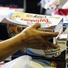 FILE - In this Nov. 16, 2012 file photo, a cashier rings up boxes of Hostess Twinkies and Cup Cakes at the Hostess Brands\' bakery in Denver. Blaming a labor dispute for ongoing financial woes, Hostess Brands decided to close shop this year, taking with it lunch box staples such as Twinkies, Ding Dongs and Wonder bread. The company said it would try to sell off its more storied brands, so maybe there is hope for the mysteriously enduring snack cakes. (AP Photo/Brennan Linsley, File)