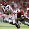 Photo - Oklahoma's Chris Brown (29) is tackled by Nebraska's Phillip Dillard in the first half of their NCAA college football game in Lincoln, Neb., Saturday, Nov. 7, 2009. AP PHOTO