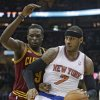 New York Knicks\' Carmelo Anthony (7) drives past Cleveland Cavaliers\' Luol Deng, (9) during the first quarter of an NBA basketball game Saturday, March 8, 2014, in Cleveland. (AP Photo/Tony Dejak)