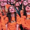 Three Oklahoma State students in a sorority watch a video played on Oklahoma State\'s new video board during Oklahoma State\'s Homecoming and Hoops event at Gallagher Iba Arena in Stillwater on October 18, 2013. Photo by KT King/For the Oklahoman