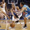 Oklahoma City Thunder\'s Russell Westbrook (0) passes the ball past New Orleans Hornets\' Xavier Henry (4) and Brian Roberts (22) during the NBA basketball game between the Oklahoma City Thunder and the New Orleans Hornets at the Chesapeake Energy Arena on Wednesday, Feb. 27, 2013, in Oklahoma City, Okla. Photo by Chris Landsberger, The Oklahoman