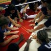 Members of the U.S. Paralympic Volleyball team meet at mid-court during practice at the University of Central Oklahoma in Edmond, on Tuesday, July 29, 2008. By John Clanton, The Oklahoman