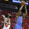 Oklahoma City\'s Kevin Durant (35) shoots the ball beside Houston\'s James Harden (13) during Game 6 in the first round of the NBA playoffs between the Oklahoma City Thunder and the Houston Rockets at the Toyota Center in Houston, Texas, Friday, May 3, 2013. Photo by Bryan Terry, The Oklahoman