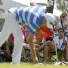 Fans watch as Steen Tinning gets ready to putt on the ninth green during the third round of the U.S. Senior Open golf tournament at Oak Tree National in Edmond, Okla., Saturday, July 12. Photo by Bryan Terry, The Oklahoman