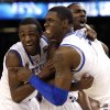 Photo -   Kentucky guard Doron Lamb,left, forward Terrence Jones (3) and guard Marquis Teague celebrate after the NCAA Final Four tournament college basketball championship game Monday, April 2, 2012, in New Orleans. Kentucky won 67-59(AP Photo/David J. Phillip)